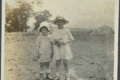 Eloise and Anna Mary Standing in a Field