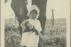 Anna Mary Holding Flowers