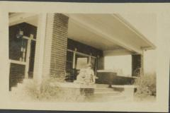 Eloise Rodkey and Young Boy on Front Porch