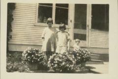 Anna Mary and Eloise Standing in Front of a House