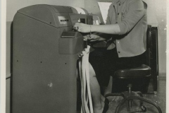 Woman at Teletype Machine at Eagle Milling Co.