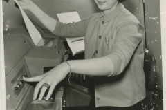 Woman at Teletype Machine