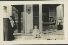 Young Girl Sitting on Porch of Rodkey House