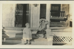 Two Children on Front Porch