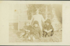 Four kids in Front of a House